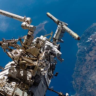exterior shot of astronauts working on the space station